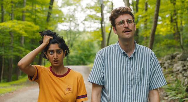 This image released by Bleecker Street shows Sunita Mani, left, and John Reynolds in a scene from