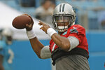 Carolina Panthers quarterback Cam Newton looks to pass during a Fan Fest practice at the NFL football team's training camp in Charlotte, N.C., Friday, Aug. 2, 2019. (AP Photo/Chuck Burton)