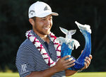 Xander Schauffele holds the champions trophy after the final round of the Tournament of Champions golf event, Sunday, Jan. 6, 2019, at Kapalua Plantation Course in Kapalua, Hawaii. (AP Photo/Matt York)