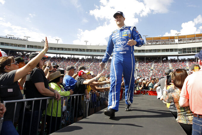 Ryan Preece greets fans during driver introductions prior to the NASCAR Cup Series auto race at ISM Raceway, Sunday, Nov. 10, 2019, in Avondale, Ariz. (AP Photo/Ralph Freso)