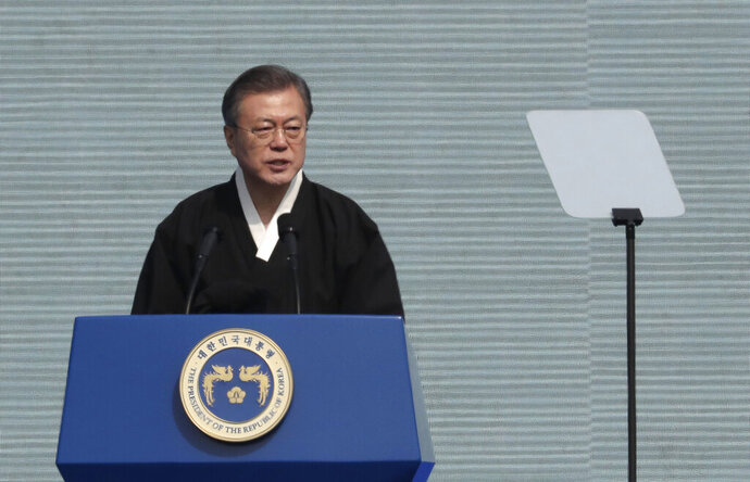 South Korean President Moon Jae-in delivers a speech during a ceremony to mark the 100th anniversary of the March First Independence Movement Day, the anniversary of the 1919 uprising against Japanese colonial rule, in Seoul, South Korea, Friday, March 1, 2019. (AP Photo/Lee Jin-man)