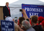 President Donald Trump arrives for a campaign rally at Minuteman Aviation Hangar, Thursday, Oct. 18, 2018, in Missoula, Mont. (AP Photo/Carolyn Kaster)