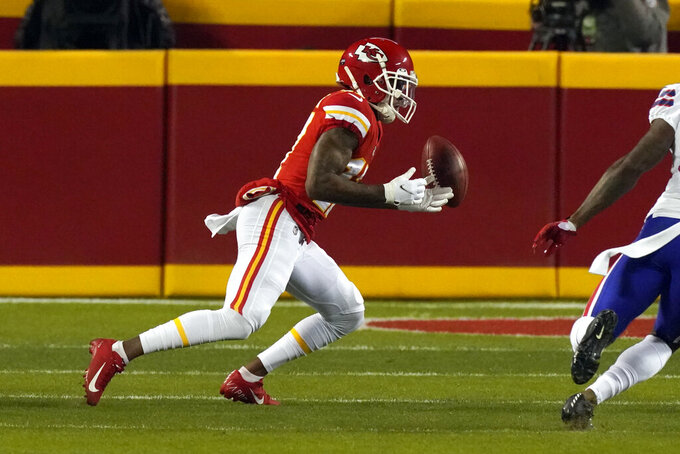 Kansas City Chiefs wide receiver Mecole Hardman fumbles a punt during the first half of the AFC championship NFL football game against the Buffalo Bills, Sunday, Jan. 24, 2021, in Kansas City, Mo. Buffalo recovered the fumble. (AP Photo/Charlie Riedel)
