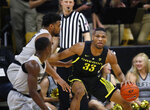Oregon forward Francis Okoro, right, looks to pass the ball as Colorado guard McKinley Wright IV, front left, and forward Evan Battey defend during the second half of an NCAA basketball game Saturday, Feb. 2, 2019, in Boulder, Colo. Colorado won 73-51. (AP Photo/David Zalubowski)