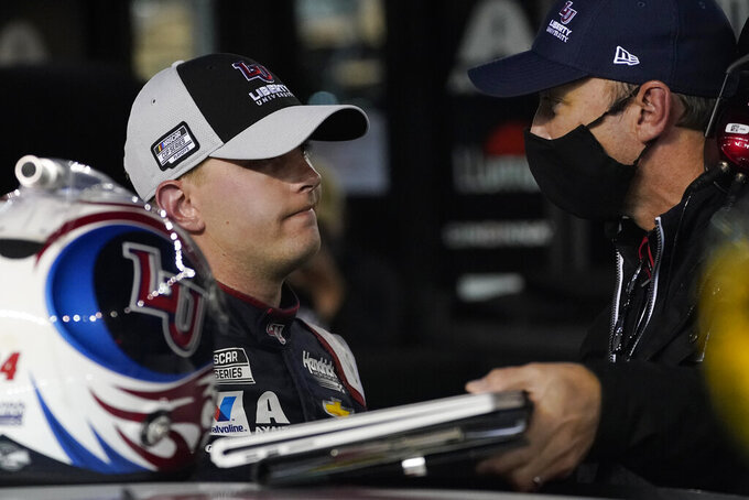 William Byron, left, talks with his crew chief after an accident during the NASCAR Cup Series auto race Saturday, Sept. 19, 2020, in Bristol, Tenn. (AP Photo/Steve Helber)