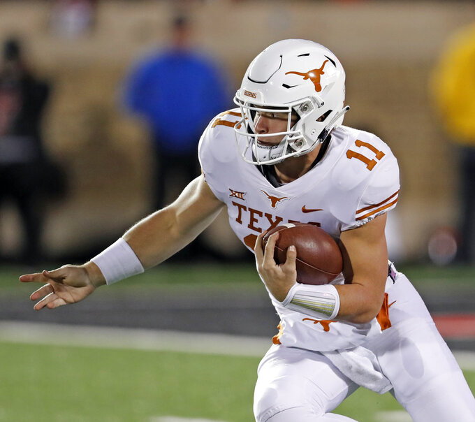 Texas' Sam Ehlinger runs with the ball during the first half of an NCAA college football game against Texas Tech, Saturday, Nov. 10, 2018, in Lubbock, Texas. (AP Photo/Brad Tollefson)