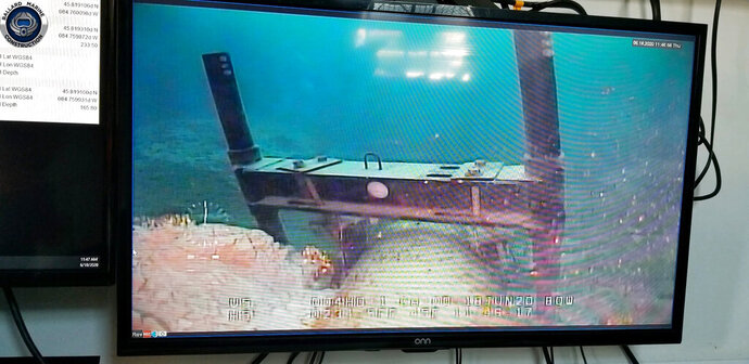 This June 2020 photo, shot from a television screen provided by the Michigan Department of Environment, Great Lakes, and Energy shows damage to anchor support EP-17-1 on the east leg of the Enbridge Line 5 pipeline within the Straits of Mackinac in Michigan. Enbridge who provided the photos to the state of Michigan, last week said an anchor support on the east leg of the pipeline, top center, had shifted. A judge has shut down the pipeline in Michigan's Great Lakes, granting a request from the state. The judge says Enbridge hasn't provided enough information to show that continued operation of the west leg of the twin pipeline is safe. (Michigan Department of Environment, Great Lakes, and Energy via AP)