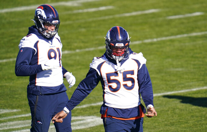 Denver Broncos outside linebacker Bradley Chubb, front, and linebacker Anthony Chickillo take part in drills during NFL football practice at the team's headquarters Wednesday, Nov. 25, 2020, in Englewood, Colo. (AP Photo/David Zalubowski)