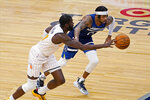 Orlando Magic's James Ennis III, left, drives as Minnesota Timberwolves' D'Angelo Russell defends during the first half of an NBA basketball game Wednesday, Jan. 20, 2021, in Minneapolis. (AP Photo/Jim Mone)