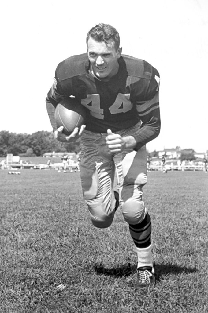 This 1950s era photo provided by the Green Bay Packers shows Bobby Dillon. Dillon initially planned to retire after the '58 season for the simple reason he could make more money working for Wilsonart, a countertop company for which he eventually became the CEO. But Vince Lombardi took charge as Packers coach in 1959 and asked Dillon to return, calling him the NFL's best defensive back. Dillon passed away at age 89 in August 2019, five months before he was selected for the Hall of Fame as part of the centennial class. (Green Bay Packers via AP)