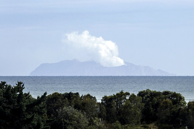 FILE - In this Dec. 11, 2019, file photo, plumes of steam rise above White Island off the coast of Whakatane, New Zealand. Another person who suffered critical injuries from an eruption of the New Zealand volcano last month has died, bringing the death toll to 21, police said Wednesday, Jan. 29, 2020. (AP Photo/Mark Baker, File)