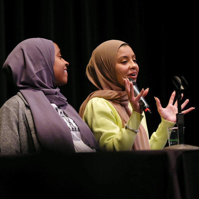 Noor Abukaram, right, speaks during the panel during the Let Noor Run Kickoff Event at Lourdes University's Franciscan Center in Sylvania, Ohio, on Friday, Jan. 24, 2020. The Ohio Senate has approved legislation Wednesday, June 9, 2021, to protect athletes' religious expression. The bill was inspired by Abukaram, an Ohio teen disqualified from a cross-country race for wearing a hijab without a required waiver. (Kurt Steiss/The Blade via AP)