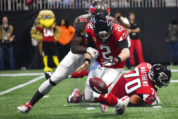 Tampa Bay Buccaneers linebacker Shaquil Barrett (58) sacks Atlanta Falcons quarterback Matt Ryan (2) causing a fumble that Ryan recovered during the first half of an NFL football game, Sunday, Nov. 24, 2019, in Atlanta. (AP Photo/John Amis)