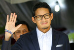 Indonesian vice presidential candidate Sandiaga Uno gestures during a press conference in Jakarta, Indonesia, Friday, May 24, 2019. The defeated candidate in Indonesia's presidential elections has filed a challenge against the result in the country's top court just days after seven people died during rioting by his supporters in the capital. (AP Photo/Achmad Ibrahim)