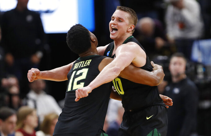 Baylor guards Jared Butler (12) and Makai Mason (10) celebrate the team's win over Syracuse in a first-round game in the NCAA men's college basketball tournament Thursday, March 21, 2019, in Salt Lake City. (AP Photo/Jeff Swinger)