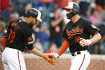 Baltimore Orioles' Trey Mancini (16) celebrates his home run with Renato Nunez (39) during the first inning of a baseball game against the Boston Red Sox, Friday, June 14, 2019, in Baltimore. (AP Photo/Nick Wass)