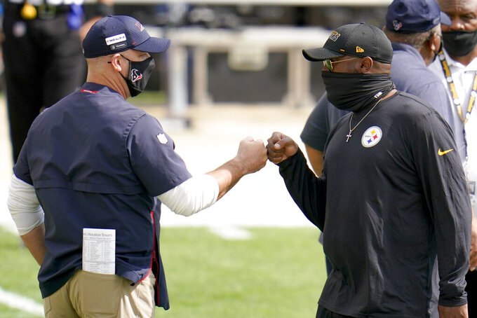 Houston Texans head coach Bill O'Brien, left, greets Pittsburgh Steelers head coach Mike Tomlin before an NFL football game, Sunday, Sept. 27, 2020, in Pittsburgh. (AP Photo/Gene J. Puskar)