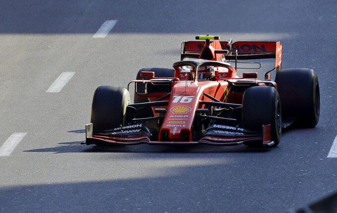 Ferrari driver Charles Leclerc of Monaco steers his car during the Formula One Grand Prix at the Baku Formula One city circuit in Baku, Azerbaijan, Sunday, April 28, 2019. (AP Photo/Sergei Grits)