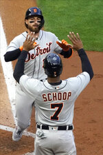 Detroit Tigers Eric Haase, rear, and Jonathan Schoop celebrates Haase's two-run home run off Minnesota Twins pitcher J.A. Happ during the fourth inning of a baseball game Thursday, July 8, 2021, in Minneapolis. (AP Photo/Jim Mone)