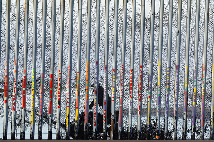 A U.S. Border Patrol agent rides a vehicle on the beach in San Diego, Wednesday, Jan. 9, 2019, seen through the border wall from Tijuana, Mexico. U.S. President Donald Trump walked out of his negotiating meeting with congressional leaders Wednesday —