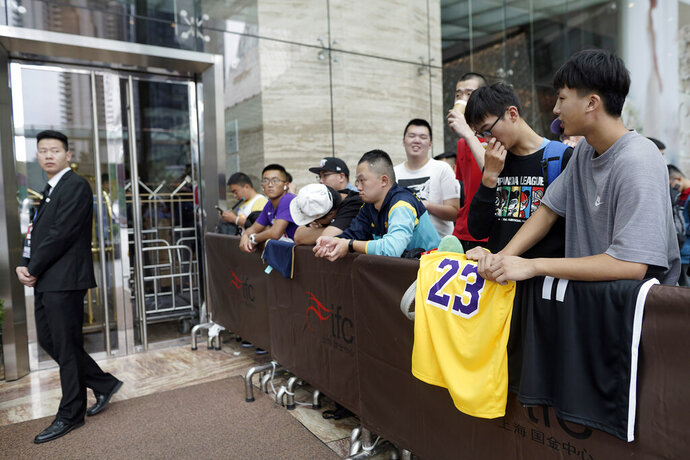 Chinese basketball fans gather outside of a hotel for a press conference that was later postponed ahead of an NBA preseason basketball game on Thursday between the Los Angeles Lakers and Brooklyn Nets in Shanghai, China, Wednesday, Oct. 9, 2019. The NBA has postponed Wednesday's scheduled media sessions in Shanghai for the Brooklyn Nets and Los Angeles Lakers, and it remains unclear if the teams will play in China this week as scheduled. (AP Photo)