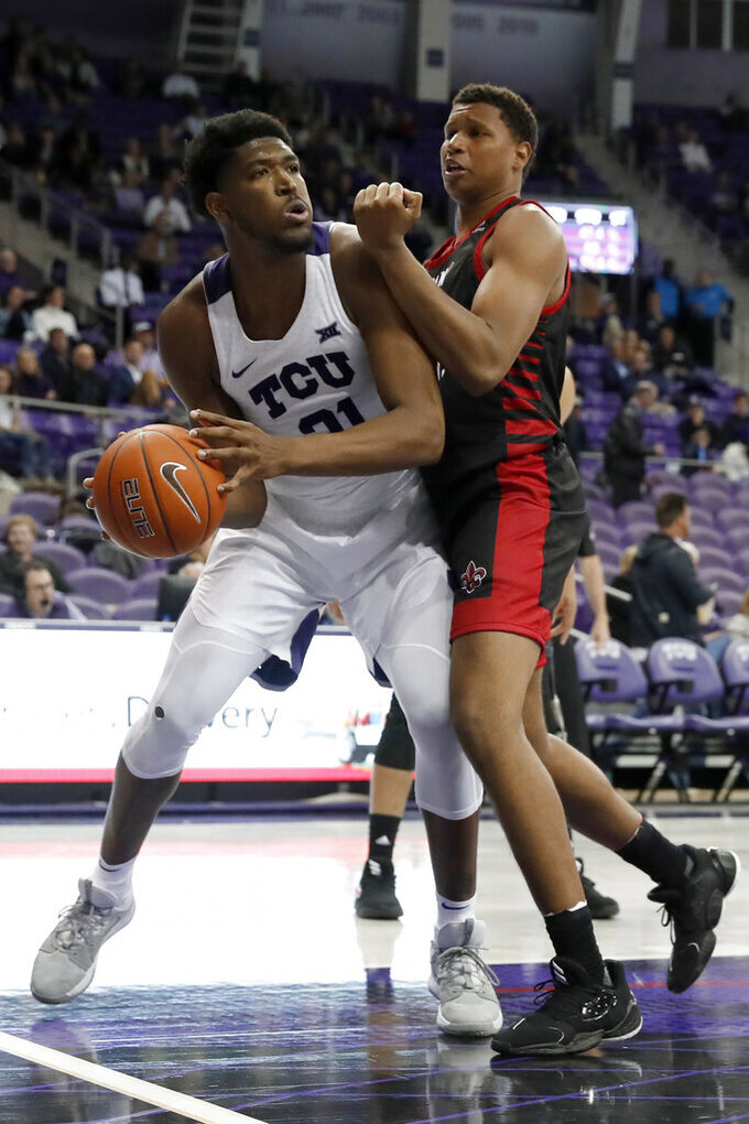 TCU center Kevin Samuel (21) works against Louisiana-Lafayette forward Jalen Johnson (1) during the second half of an NCAA college basketball game in Fort Worth, Texas, Tuesday, Nov. 12, 2019. (AP Photo/Tony Gutierrez)