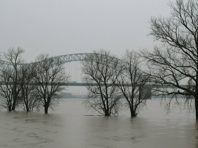 A low-lying park sits flooded by the swollen Mississippi River on Friday, Feb. 22, 2019 in Memphis, Tenn. Located on Memphis' Mud Island, Greenbelt Park (pictured) floods when the Mississippi River reaches high levels. (AP Photo/Adrian Sainz).