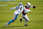 Arizona Cardinals wide receiver DeAndre Hopkins is tackled by Carolina Panthers cornerback Rasul Douglas during the first half of an NFL football game Sunday, Oct. 4, 2020, in Charlotte, N.C. (AP Photo/Brian Blanco)