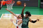 Portland Trail Blazers' Enes Kanter (11) and Boston Celtics' Robert Williams III (44) battle for a rebound during the second half of an NBA basketball game, Sunday, May 2, 2021, in Boston. (AP Photo/Michael Dwyer)