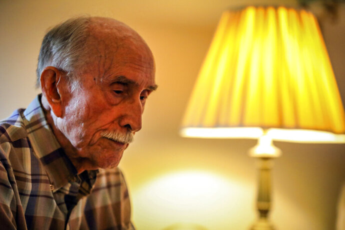 WWII veteran Loyd W. Brandt at his home on Wednesday in Rapid City, S.D.   For Loyd, 93, pride in his life-saving recon missions sometimes washes into remembrances like those of touching sand-covered dead on Iwo Jima. Some nights, those memories still sail uninvited across the intervening decades.  (Adam Fondren/Rapid City Journal via AP)