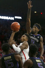 Arizona guard Brandon Randolph, center, eyes the basket while urrounded by Washington forward Noah Dickerson (15), guard Jaylen Nowell (5) and forward Nahziah Carter (11) in the first half of an NCAA college basketball game in Tucson, Ariz., Thursday, Feb. 7, 2019. (Mamta Popat/Arizona Daily Star via AP)