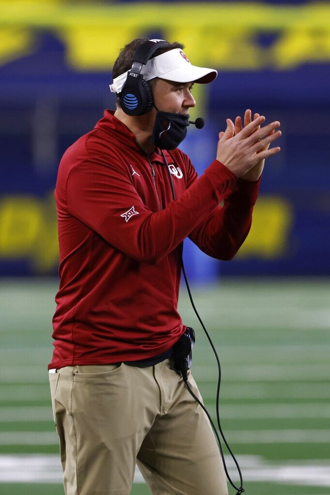 Oklahoma coach Lincoln Riley cheers on the team during the second half of the Cotton Bowl NCAA college football game against Florida in Arlington, Texas, Wednesday, Dec. 30, 2020. (AP Photo/Ron Jenkins)