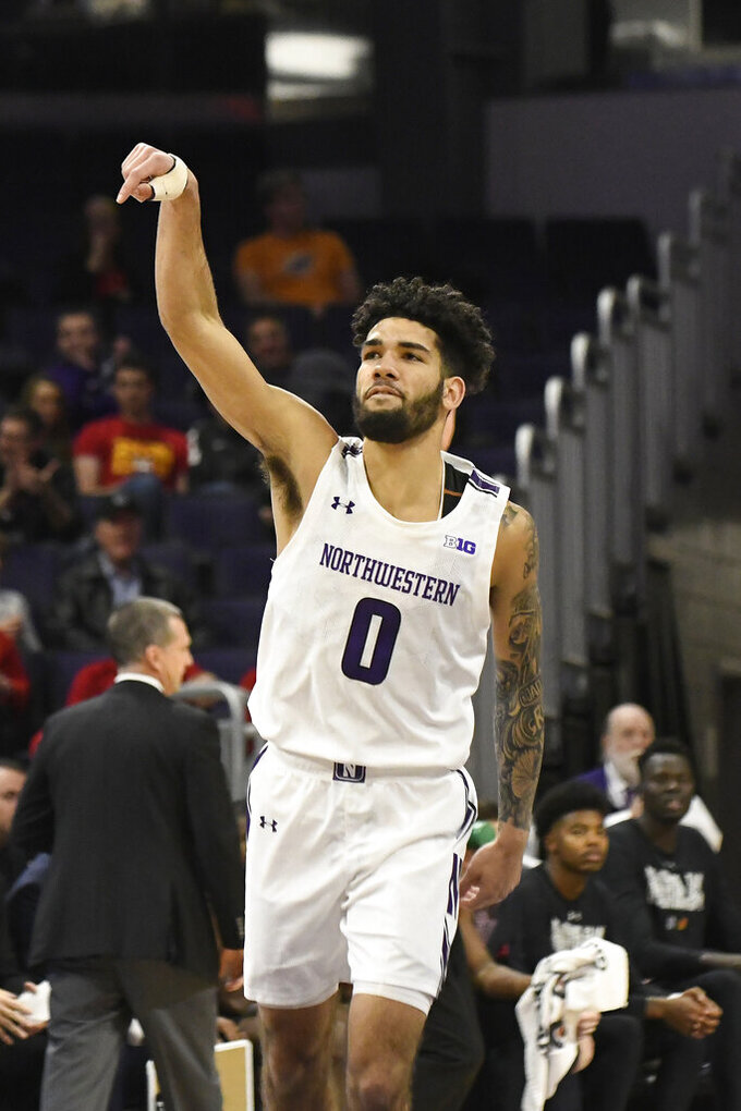 Northwestern guard Boo Buie (0) gestures after making a three point basket against Maryland during the first half of an NCAA college basketball game, Tuesday, Jan. 21, 2020, in Evanston, Ill. (AP Photo/David Banks)