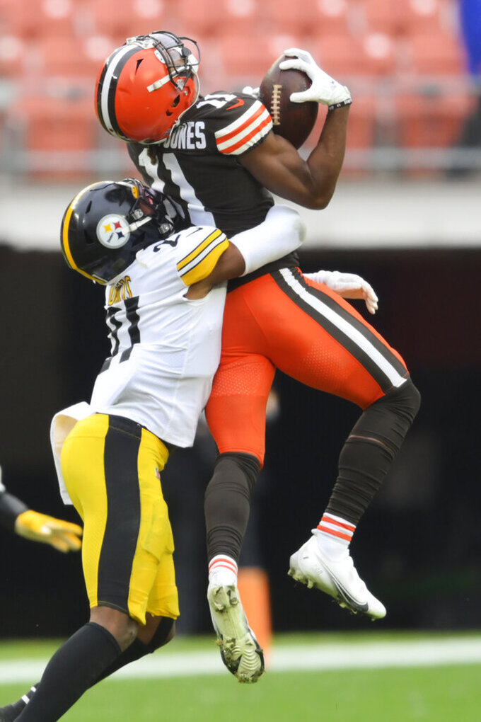 Pittsburgh Steelers free safety Sean Davis (21) tackles Cleveland Browns wide receiver Donovan Peoples-Jones (11) during the first half of an NFL football game, Sunday, Jan. 3, 2021, in Cleveland. Peoples-Jones left the game with an injury after the play. (AP Photo/David Richard)