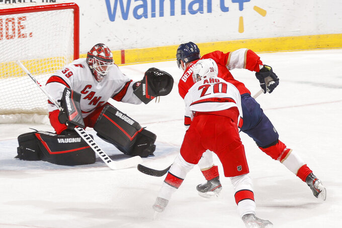 Carolina Hurricanes goaltender Alex Nedeljkovic (39) stops a shot by Florida Panthers center Sam Bennett (9) during the first period of an NHL hockey game Saturday, April 24, 2021, in Sunrise, Fla. (AP Photo/Joel Auerbach)