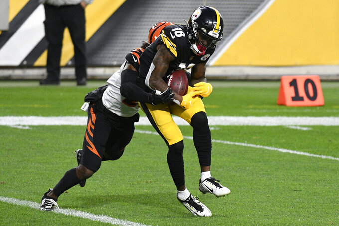 Pittsburgh Steelers wide receiver Diontae Johnson (18) catches a 12-yard touchdown pass from quarterback Ben Roethlisberger with Cincinnati Bengals defensive back Tony Brown (27) defending during the first half of an NFL football game in Pittsburgh, Sunday, Nov. 15, 2020. (AP Photo/Don Wright)