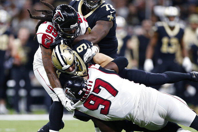 New Orleans Saints quarterback Drew Brees (9) is sacked by Atlanta Falcons defensive tackle Grady Jarrett (97) and defensive tackle Shy Tuttle (99) in the second half of an NFL football game in New Orleans, Sunday, Nov. 10, 2019. (AP Photo/Rusty Costanza)