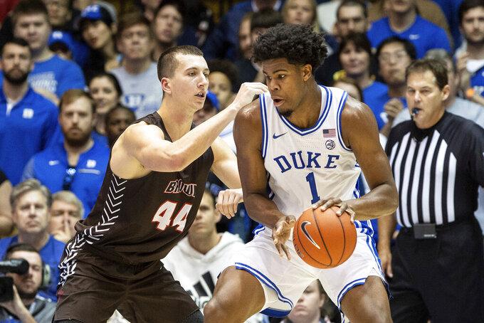 Duke's Vernon Carey Jr. (1) works in the post against Brown's Matt DeWolf (44) during the first half of an NCAA college basketball game in Durham, N.C., Saturday, Dec. 28, 2019. (AP Photo/Ben McKeown)