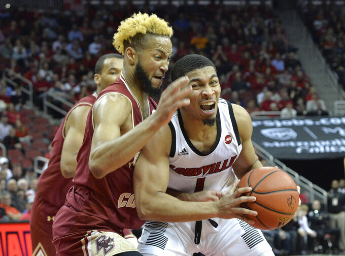 Louisville guard Christen Cunningham (1) attempts to get inside the defensive pressure of \bo\ during the second half of an NCAA college basketball game in Louisville, Ky., Wednesday, Jan. 16, 2019. Louisville won 80-70. (AP Photo/Timothy D. Easley)