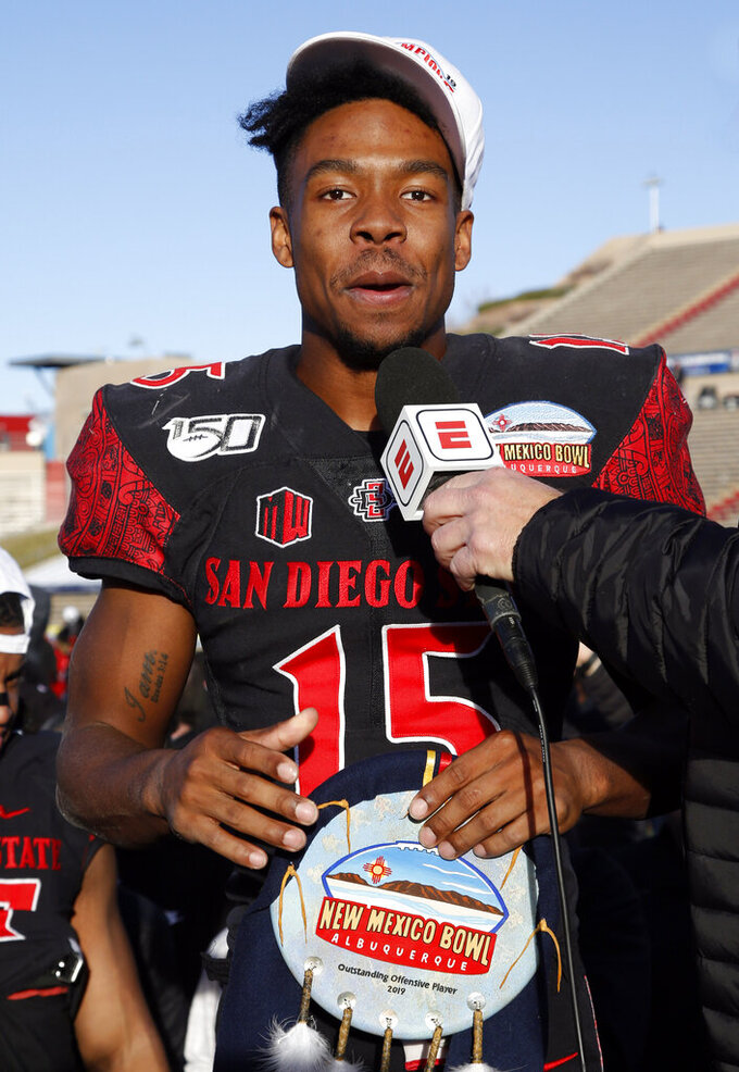 San Diego State running back Jordan Byrd, one of the two recipients of the offensive MVP award, speaks during the presentation of the New Mexico Bowl NCAA college football game on Saturday, Dec. 21, 2019 in Albuquerque, N.M. San Diego State beat Central Michigan 48-11. (AP Photo/Andres Leighton)