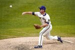 Milwaukee Brewers' Jedd Gyorko pitches during the ninth inning of a baseball game against the Minnesota Twins Wednesday, Aug. 12, 2020, in Milwaukee. (AP Photo/Morry Gash)
