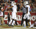 San Jose State receiver Isaiah Holiness (1) celebrates with teammate Jermaine Braddock after scoring a touchdown against Arkansas during the first half of an NCAA college football game, Saturday, Sept. 21, 2019 in Fayetteville, Ark. (AP Photo/Michael Woods)
