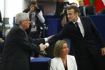 French President Emmanuel Macron, right, shakes hands with European Commission President Jean-Claude Juncker at the European Parliament in Strasbourg, eastern France, Tuesday, April 17, 2018. Macron is expected to outline his vision for the future of Europe to push for deep reforms of the 19-nation eurozone and will launch a drive to seek European citizens' opinions on the European Union's future. (AP Photo/ Jean Francois Badias)