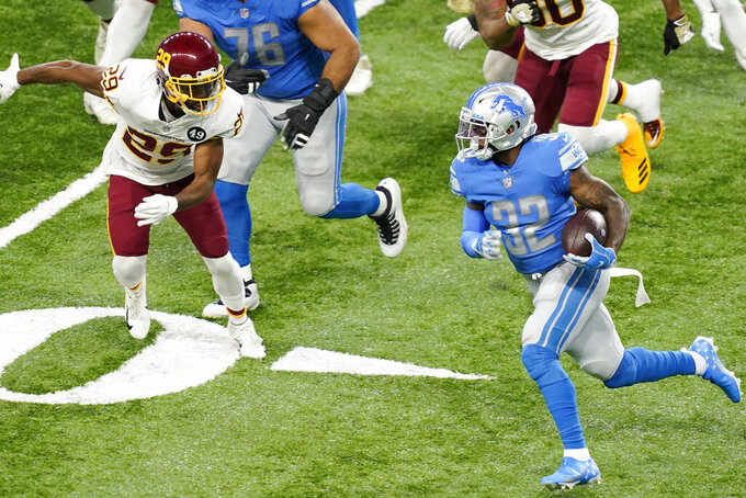 Detroit Lions running back D'Andre Swift (32) rushes during the first half of an NFL football game against the Washington Football Team, Sunday, Nov. 15, 2020, in Detroit. (AP Photo/Carlos Osorio)
