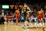Iowa center Luka Garza (55) walks on the court at the end of an NCAA college basketball game against Iowa State, Thursday, Dec. 12, 2019, in Ames, Iowa. Iowa won 84-68. (AP Photo/Charlie Neibergall)