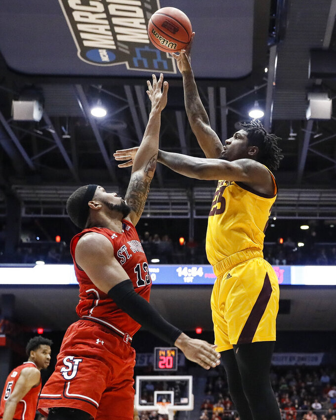 Arizona State's Romello White, right, shoots over St. John's Marvin Clark II (13) during the first half of a First Four game of the NCAA men's college basketball tournament Wednesday, March 20, 2019, in Dayton, Ohio. (AP Photo/John Minchillo)