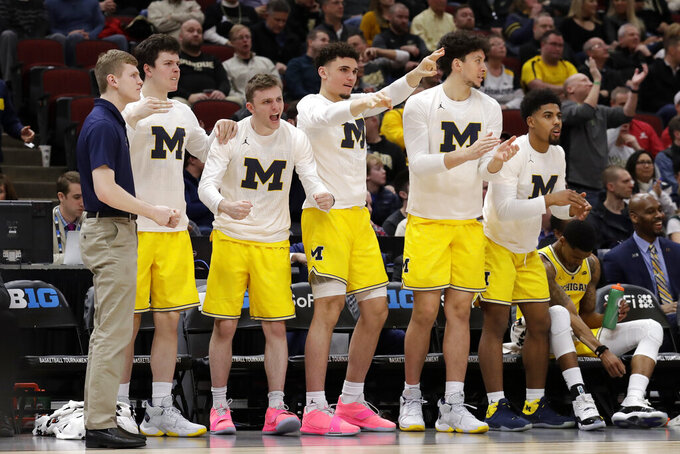 Michigan bench react during the first half of an NCAA college basketball game against Iowa in the quarterfinals of the Big Ten Conference tournament, Friday, March 15, 2019, in Chicago. (AP Photo/Nam Y. Huh)