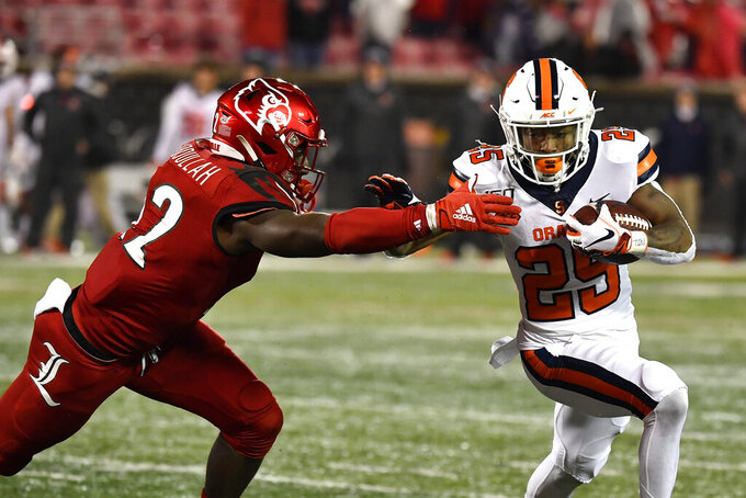 Louisville linebacker Yasir Abdullah (22) attempts to bring down Syracuse running back Jawhar Jordan (25) during the second half of an NCAA college football game in Louisville, Ky., Saturday, Nov. 23, 2019. (AP Photo/Timothy D. Easley)