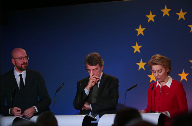From right, European Commission President Ursula von der Leyen, European Parliament President David Sassoli and European Council President Charles Michel participate in speak a media conference at the Parliamentarium in Brussels, Friday, Jan. 31, 2020. The U.K. is due to leave the EU on Friday the first nation in the bloc to do so. (AP Photo/Virginia Mayo)