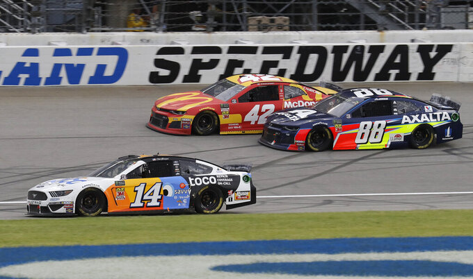 Clint Bowyer (14), Kyle Larson (42) and Alex Bowman (88) compete during a NASCAR Cup Series auto race at Chicagoland Speedway in Joliet, Ill., Sunday, June 30, 2019. (AP Photo/Nam Y. Huh)